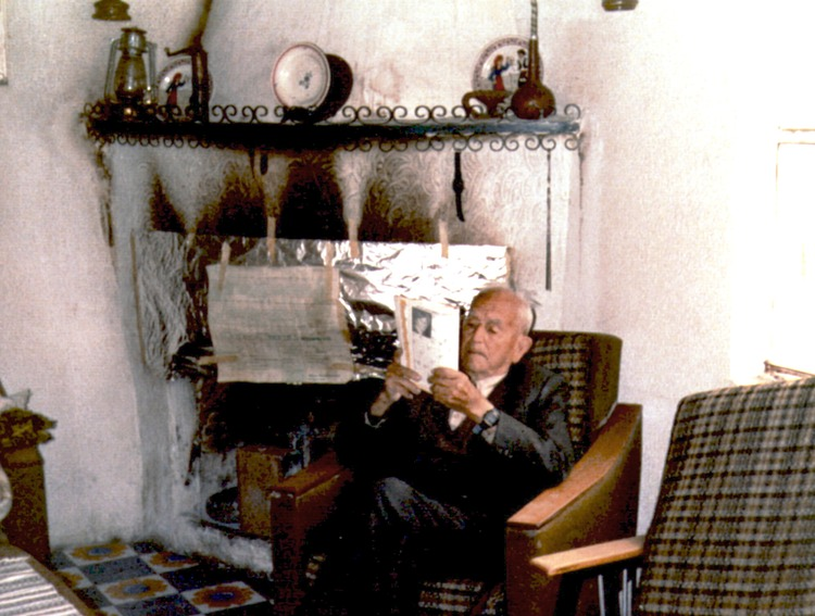 Anastasis Polis reading newspaper fireplace Anoi